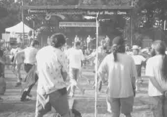 "Tapers protecting their equipment during ""The Feldmans""- Fingerlakes Grassroots Festival - 1995"